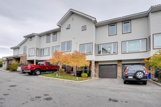 Main Photo: 219 Coachway Lane SW in Calgary: Coach Hill Row/Townhouse for sale : MLS®# A1152032
