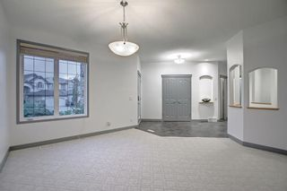 Photo 5: 163 Springbluff Heights SW in Calgary: Springbank Hill Detached for sale : MLS®# A1153228