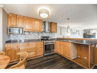 """Photo 9: 157 27111 0 Avenue in Langley: Aldergrove Langley Manufactured Home for sale in """"Pioneer Park"""" : MLS®# R2597222"""