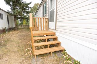 """Photo 2: 22 2123 RIVERSIDE Drive in Smithers: Smithers - Town Manufactured Home for sale in """"Riverside Park"""" (Smithers And Area (Zone 54))  : MLS®# R2325255"""