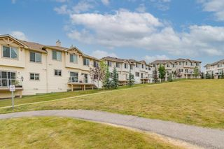 Photo 32: 296 Sunset Point: Cochrane Row/Townhouse for sale : MLS®# A1134676