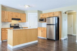 Photo 6: 23 TUSCARORA WY NW in Calgary: Tuscany House for sale : MLS®# C4174470