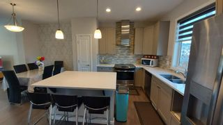 Photo 4: 110 Auburn Meadows Avenue SE in Calgary: Auburn Bay Semi Detached for sale : MLS®# A1095114