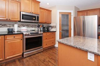 Photo 5: 3 Elmont Rise SW in Calgary: Springbank Hill Detached for sale : MLS®# A1091321