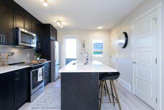 Photo 10: 206 338 Seton Circle SE in Calgary: Seton Row/Townhouse for sale : MLS®# A1042558