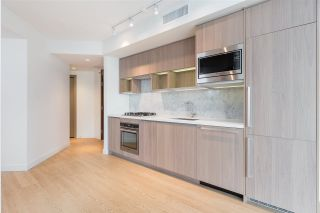 "Photo 1: 1720 68 SMITHE Street in Vancouver: Downtown VW Condo for sale in ""ONE PACIFIC"" (Vancouver West)  : MLS®# R2401692"