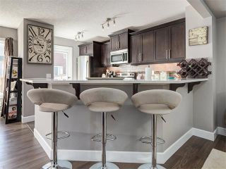 Photo 7: 18 WINDWOOD Grove SW: Airdrie House for sale : MLS®# C4082940