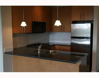"""Photo 4: 304 3551 FOSTER Avenue in Vancouver: Collingwood Vancouver East Condo for sale in """"FINALE"""" (Vancouver East)  : MLS®# V654747"""