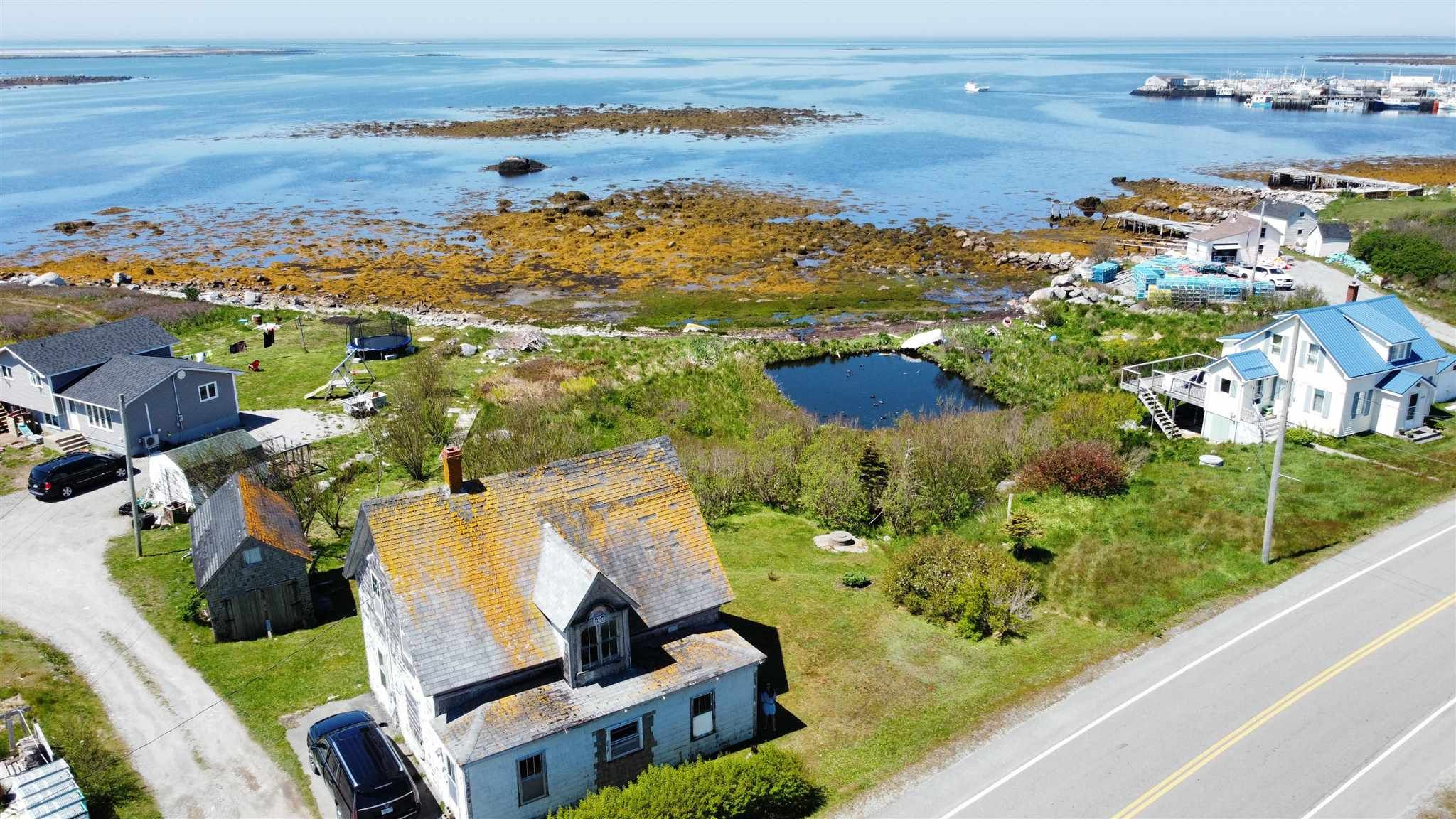 Main Photo: 2844 Main Street in Clark's Harbour: 407-Shelburne County Residential for sale (South Shore)  : MLS®# 202113865