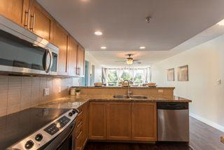 """Photo 8: 203 288 UNGLESS Way in Port Moody: North Shore Pt Moody Condo for sale in """"CRESCENDO"""" : MLS®# R2185282"""