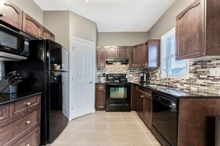 Photo 10: 130 Bishop Crescent NW: Langdon Detached for sale : MLS®# A1078277