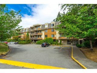 """Photo 1: 302 1720 SOUTHMERE Crescent in White Rock: Sunnyside Park Surrey Condo for sale in """"Capstan Way"""" (South Surrey White Rock)  : MLS®# R2602939"""