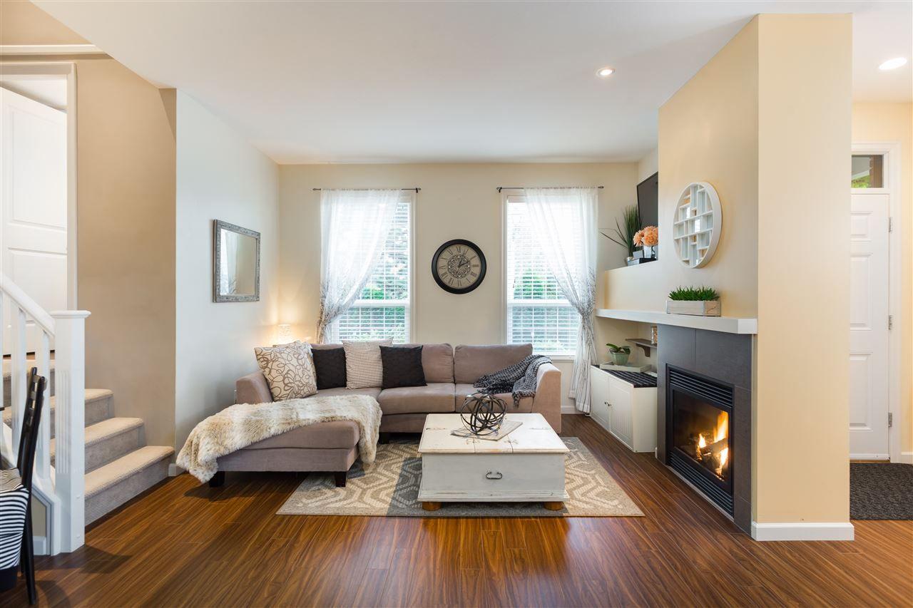 Cozy living room with gas fireplace  www.6894-208street.com