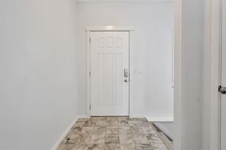 Photo 3: 2 Ravenswynd Rise SE: Airdrie Detached for sale : MLS®# A1073616