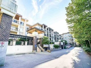 """Photo 1: 107 9655 KING GEORGE Boulevard in Surrey: Whalley Condo for sale in """"The Gruv"""" (North Surrey)  : MLS®# R2560249"""