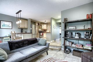 Photo 2: 373 Point Mckay Gardens NW in Calgary: Point McKay Row/Townhouse for sale : MLS®# A1063969