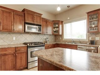 Photo 15: 118 PANATELLA CI NW in Calgary: Panorama Hills House for sale : MLS®# C4078386
