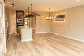 Photo 7: 166 Howse Common in Calgary: Livingston Detached for sale : MLS®# A1143791