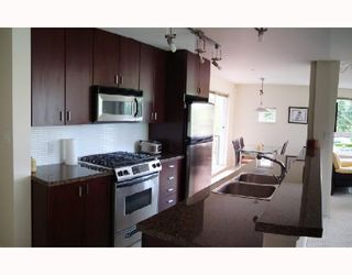 """Photo 3: 310 6888 SOUTHPOINT Drive in Burnaby: South Slope Condo for sale in """"CORTINA"""" (Burnaby South)  : MLS®# V714781"""
