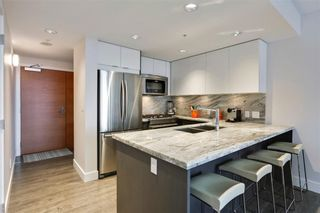 Photo 7: 405 519 Riverfront Avenue SE in Calgary: Downtown East Village Apartment for sale : MLS®# A1081632