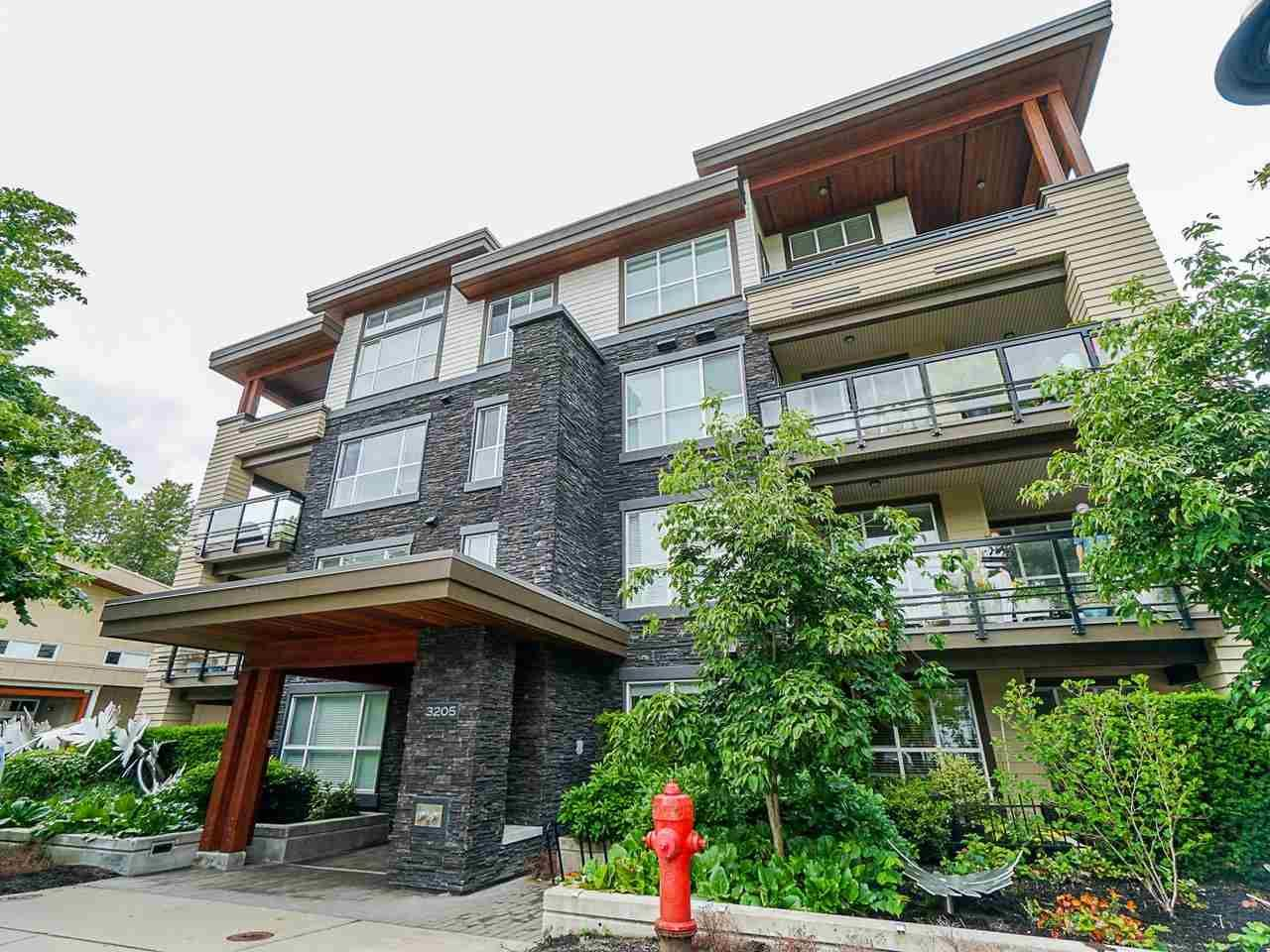 "Photo 1: Photos: 302 3205 MOUNTAIN Highway in North Vancouver: Lynn Valley Condo for sale in ""Mill House"" : MLS®# R2464769"