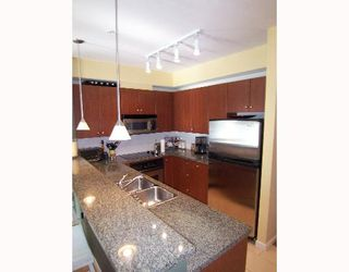 """Photo 6: 101 200 CAPILANO Road in Port_Moody: Port Moody Centre Condo for sale in """"SUTERBROOK"""" (Port Moody)  : MLS®# V646289"""