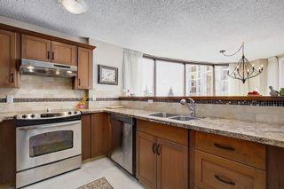Photo 12: 241 20 COACHWAY Road SW in Calgary: Coach Hill Condo for sale : MLS®# C4167445