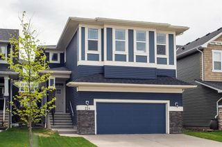 Photo 1: 224 Crestmont Drive SW in Calgary: Crestmont Detached for sale : MLS®# A1118392