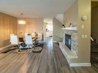 Photo 3: 27 Sandarac Road NW in Calgary: Sandstone Valley Row/Townhouse for sale : MLS®# A1148451