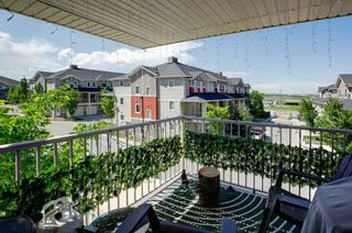 Photo 1: 1714 250 Sage Valley Road NW in Calgary: Sage Hill Row/Townhouse for sale : MLS®# A1120292