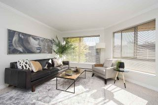 "Photo 4: 406 1859 SPYGLASS Place in Vancouver: False Creek Condo for sale in ""San Remo"" (Vancouver West)  : MLS®# R2211824"