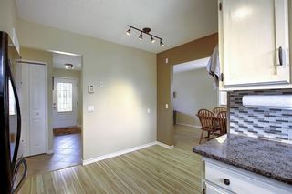 Photo 8: 408 QUEENSLAND Circle SE in Calgary: Queensland Detached for sale : MLS®# A1020270