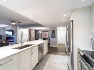 """Photo 10: 211 2665 W BROADWAY in Vancouver: Kitsilano Condo for sale in """"MAGUIRE BUILDING"""" (Vancouver West)  : MLS®# R2550864"""