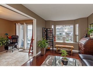 """Photo 4: 103 5641 201 Street in Langley: Langley City Townhouse for sale in """"THE HUNTINGTON"""" : MLS®# R2537246"""