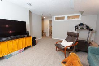 Photo 22: 179 Fireside Way: Cochrane Row/Townhouse for sale : MLS®# A1109604