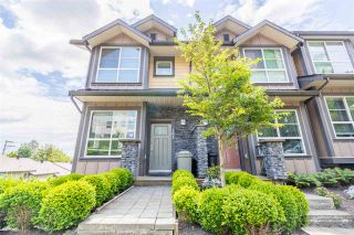 """Photo 1: 101 1418 CARTIER Avenue in Coquitlam: Maillardville Townhouse for sale in """"CARTIER PLACE"""" : MLS®# R2477824"""