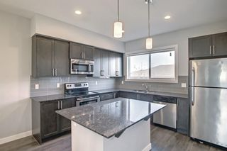 Photo 8: 862 Nolan Hill Boulevard NW in Calgary: Nolan Hill Row/Townhouse for sale : MLS®# A1141598