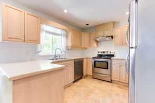 """Photo 8: 129 13888 70TH Avenue in Surrey: East Newton Townhouse for sale in """"Chelsea Gardens"""" : MLS®# R2594472"""