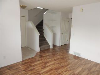 Photo 7: 350 ERIN Circle SE in Calgary: Erinwoods Residential Detached Single Family for sale : MLS®# C3644161