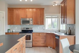 Photo 7: 146 COUGARSTONE Crescent SW in Calgary: Cougar Ridge Detached for sale : MLS®# A1015703