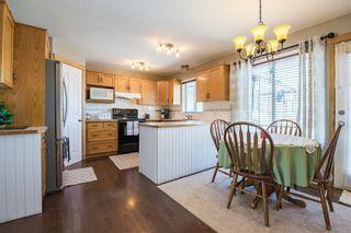 Photo 7: 59 CRYSTALRIDGE Close: Okotoks House for sale : MLS®# C4177161