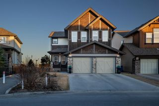 Main Photo: 124 Tremblant Way SW in Calgary: Springbank Hill Detached for sale : MLS®# A1088051