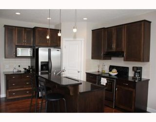 Photo 4: 98 BRIGHTONSTONE Grove SE in CALGARY: New Brighton Residential Detached Single Family for sale (Calgary)  : MLS®# C3382275