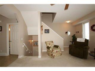 Photo 10: 155 CRAWFORD Drive: Cochrane House for sale : MLS®# C4092224