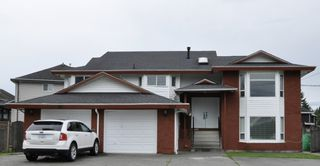 Photo 1: 7865 148 Street in Surrey: East Newton House for sale : MLS®# R2541568