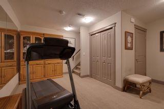 Photo 29: 40 Cougar Ridge Landing SW in Calgary: Cougar Ridge Row/Townhouse for sale : MLS®# A1148928