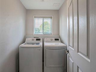 Photo 27: 426 Riverview Green: Cochrane Detached for sale : MLS®# A1132015