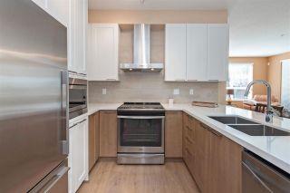 """Photo 1: 106 611 REGAN Avenue in Coquitlam: Coquitlam West Condo for sale in """"Regan's Walk"""" : MLS®# R2354478"""