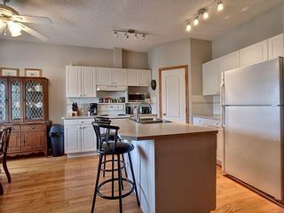 Photo 7: 40 Hamptons Link NW in Calgary: Hamptons Row/Townhouse for sale : MLS®# A1074833