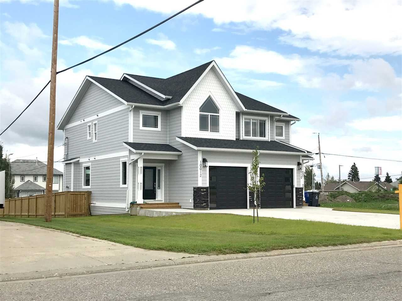 Main Photo: 10012 111 AVENUE in : Fort St. John - City NW 1/2 Duplex for sale : MLS®# R2244375